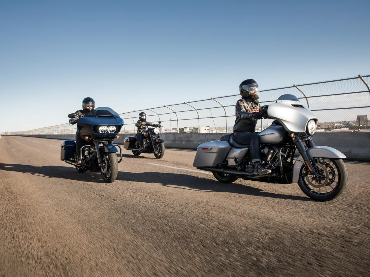 Three riders on three Harley-Davidson touring motorcycles